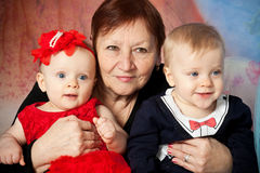 Grandma and children Stock Photography