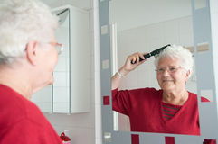 Grandma is combing the hair Royalty Free Stock Images