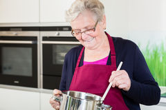 Grandma cooking comfort food. In her kitchen royalty free stock photos