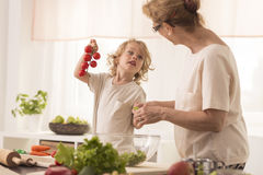Grandma cooking with grandchild Stock Images