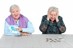 Grandma is counting money. Stock Images