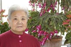 Grandma and flowers Stock Photos