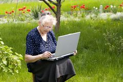 Grandma in garden Stock Image