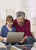 Grandma and Girl With Laptop Stock Photos