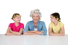 Grandma and girls with funny hair Royalty Free Stock Photography