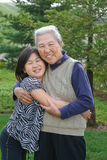 Grandma and Grand Daughter Hug Each Other Royalty Free Stock Photography