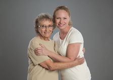 Grandma and Grand Daughter Hug Each Other Royalty Free Stock Photos
