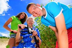 Grandma and grand kids. Teenagers with their grandma outside Stock Photography