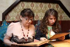 Grandma with grandchild looking menu Royalty Free Stock Photos