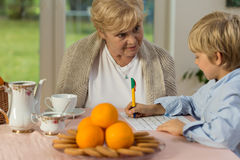 Grandma and grandchild. Spending time together at home stock images