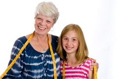 Grandma and Grandchild with Tape Measure Stock Images