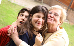 Grandma with grandchildren close up cuddle photo. On summer background royalty free stock photos