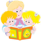Grandma and grandchildren read. Grandmother reading a book to her little granddaughter and grandson Stock Photography