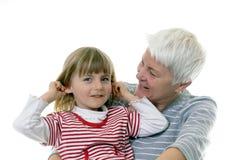 Grandma and granddaughter. White haired grandma and granddaughter Stock Photos