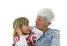 Grandma and granddaughter. Make faces Stock Photos