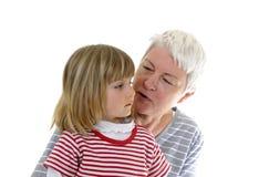 Grandma and granddaughter. Make conversation Stock Photography