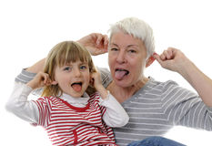 Grandma and granddaughter. Make faces Stock Images