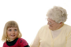 Grandma and granddaughter. Grizzled grandma and blond granddaughter Royalty Free Stock Image