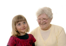 Grandma and granddaughter. Grizzled grandma and blond granddaughter Stock Image