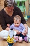Grandma with granddaughter. Grandma playing with her baby granddaughter Royalty Free Stock Photography
