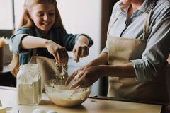 Grandma and Granddaughter Baking Kitchen at Home. Making the Dough. Grandma and Granddaughter Cooking Food. Healthy Lifestyle. Cooking At Home. Family Concept stock images