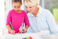 Grandma granddaughter drawing Stock Images