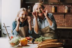 Grandma and Granddaughter Having Fun in Kitchen. Grandma and Granddaughter Cooking Food. Vegetable Salad. Diet. Dieting Concept. Healthy Lifestyle. Cooking At royalty free stock photo