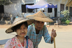 Grandma and Granddaughter in Myanmar. A Grandmother and Granddaughter posing for their photo in Myanmar Feb 2015 No model release Editorial use only Stock Images