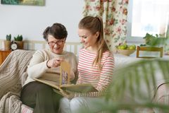 Grandma and granddaughter watching photo album Stock Images