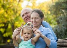 Grandma and  grandpa with  grandaughter Stock Image