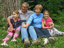 Grandma and grandpa with the grandchildren Stock Photography