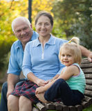 Grandma and  grandpa with little  grandaughter Stock Photography