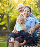Grandma and  grandpa with little grandaughter Stock Image