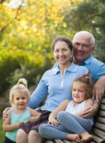 Grandma and  grandpa with littles grandaughters Royalty Free Stock Photography