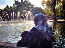 Grandma with grandson by fountain pond. Dutch  shots pics Royalty Free Stock Photography