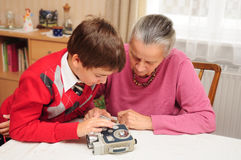 Grandma and grandson with old camera Stock Photo