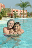 Grandma and grandson in pool Royalty Free Stock Photography