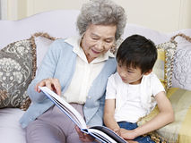 Grandma and grandson. Reading a book together Royalty Free Stock Images