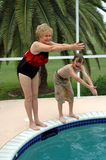 Grandma and grandson swim Stock Photography