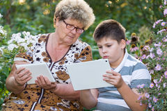 Grandma with  grandson watching tablet PC Royalty Free Stock Images