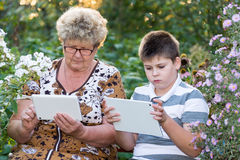Grandma with  grandson watching tablet PC Royalty Free Stock Photography