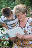 Grandma with  grandson watching tablet PC Royalty Free Stock Photos