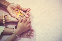 Grandma hand and grandson cancer awareness ribbon sign top view with vintage picture style royalty free stock photos