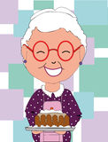 Grandma has cooked a cake Royalty Free Stock Photos