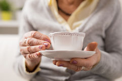 Grandma having a cup of coffee/ tea Royalty Free Stock Photos