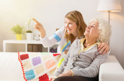 Grandma and health professional looking at something Royalty Free Stock Photos