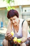 Grandma is holding juicy ripe pears. Yellow pears in elderly wrinkled hands. royalty free stock photography