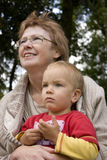 Grandma holds his grandson in his arms. Royalty Free Stock Photography