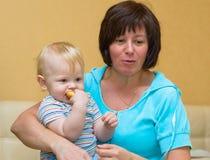 Grandma holds the newborn grandson Royalty Free Stock Images