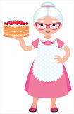 Grandma Housewife In Full Length Holds A Baked Beautiful Cake Royalty Free Stock Photo